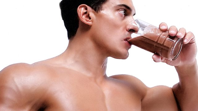 Man drinking chocolate milk after workout